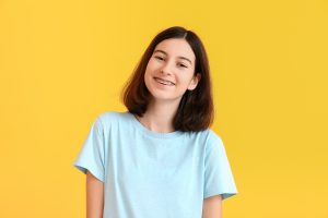 portrait of a girl smiling with her metal braces